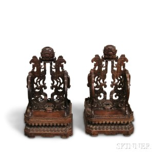 Sold for: $46,125 - Pair of Chinese Carved Hardwood Stands