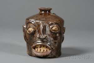 Sold for: $10,665 - Redware Pottery Grotesque Face Jug