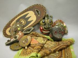 Thai Textile Hanging, Five Asian and African Masks and a Shield.