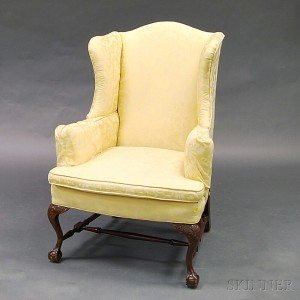 upholstered carved mahogany wing chair