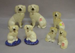 Three Pairs of Staffordshire Spaniels and a Single Spaniel Figure.