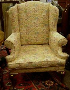 queen anne style upholstered carved mahogany wing chair