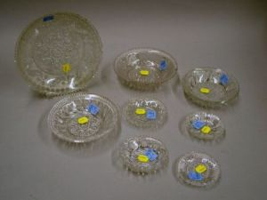 Eight Sandwich Colorless Pressed Lacy Glass Plates and Bowls.