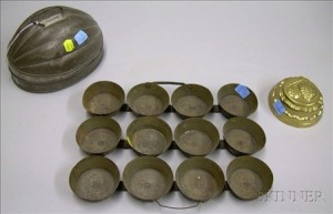 Tin Melon-form Mold, a Metal Twelve-Muffin Baking Tray, and a Brass Food Mold.
