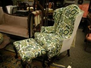 queen anne style crewelwork upholstered walnut wing chair and a crewelwork upholstered carved