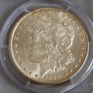 Sold for: $3,690 - 1894 Morgan Dollar PCGS MS62 Rated.     Estimate $3,000-4,000