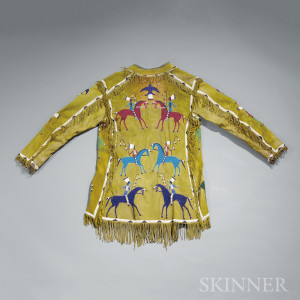 Sold for: $104,550 - Lakota Beaded Hide Pictographic Coat