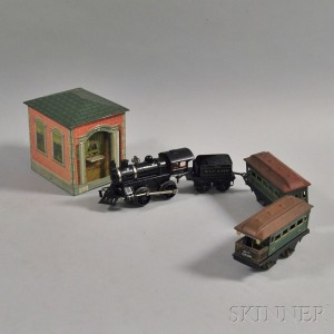Small Group of Toy Trains and a Tin Bank