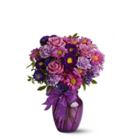 ASSORTED PURPLE FLOWERS ARRANGED