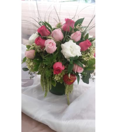 all shades of pink cylinder arrangement