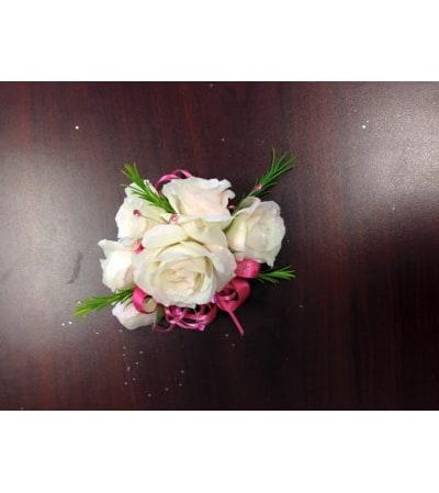 white roses pink ribbon