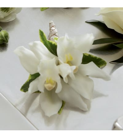 The FTD® White Cymbidium Boutonniere