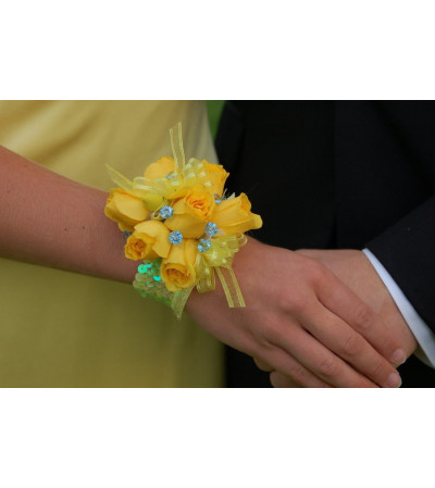 WRIST CORSAGE OF YELLOW ROSES
