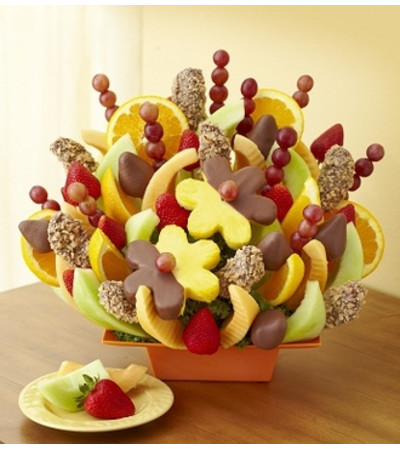 Make any celebration even more delicious with one of our signature fresh fruit arrangements! The Delicious Celebration® is a fun, brightly-colored treat filled with an assortment of all our favorite fresh fruits: pineapple stars, pineapple daisies, strawberries, and more.