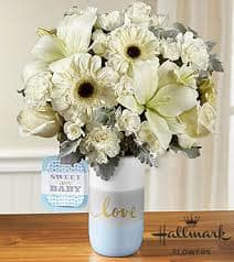 The FTD® Sweet Baby Boy™ Bouquet by Hallmark celebrates the new f