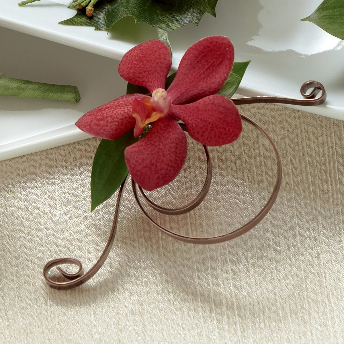The FTD® Red Mokara Boutonniere