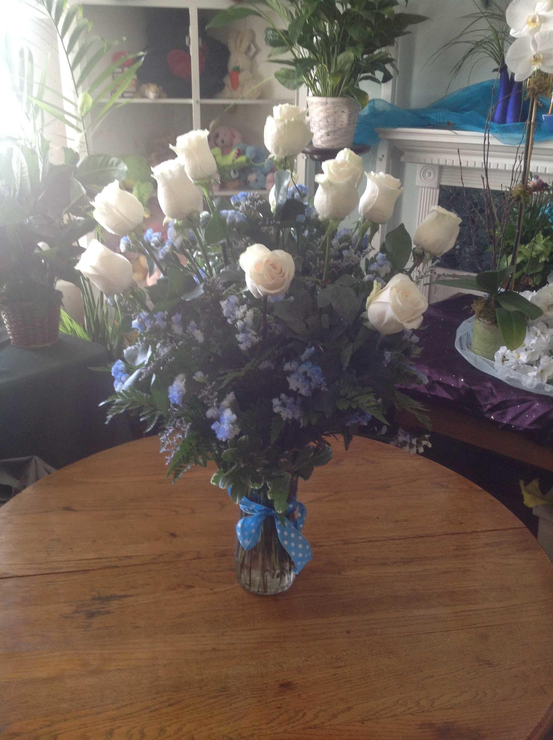 Breathtaking long stem white roses
