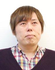 永井 健一