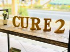 Cure2